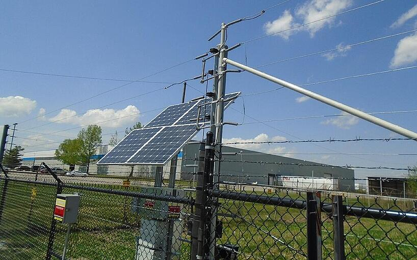 An electric security fence built directly inside the existing fence at Quality Companies
