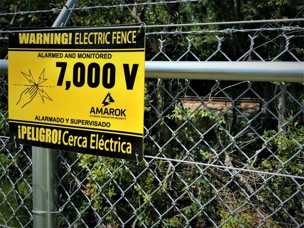 Auto Rentals Electric Fence Warning Sign