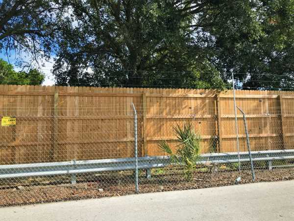 Privacy Fence and Wood Panels Security for Auto Rental Lots