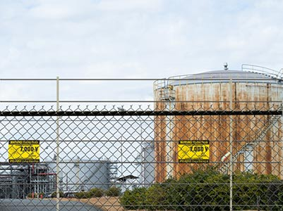 Oil Tank in Factory Perimeter Security Fence